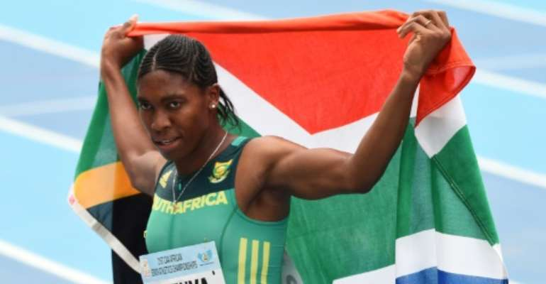Caster Semenya celebrates with the South African flag after winning the women's 800m during the African Athletics Championships in Nigeria in August 2018.  By PIUS UTOMI EKPEI (AFP/File)