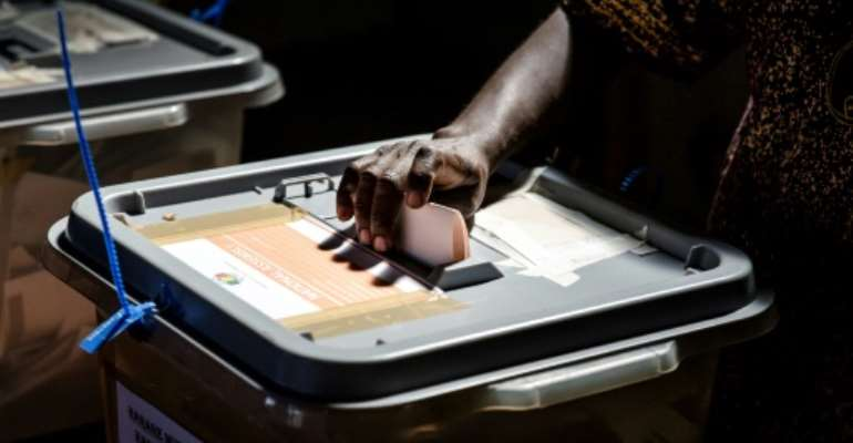 Casting a vote: The elections are the first since the end of Robert Mugabe's 37-year rule.  By Luis TATO (AFP)