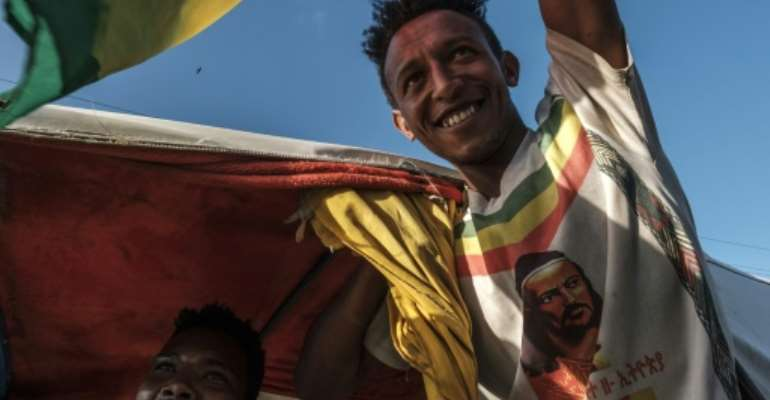 Celebrations: A man waves the Ethiopian imperial flag during an impromptu parade for freed opposition leaders in Alamata.  By EDUARDO SOTERAS (AFP)