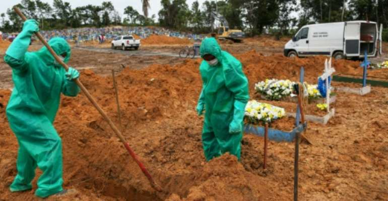 Cemetary workers dig graves for victims and suspected victims of the COVID-19 coronavirus pandemic at the Nossa Senhora cemetary in Manaus, Amazon state, Brazil.  By MICHAEL DANTAS (AFP)