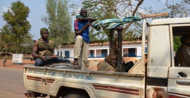 Seleka rebels sit on January 17, 2013 in a pickup truck north of Damara, 75 kms from the capital Bangui.  By Patrick Fort (AFP/File)