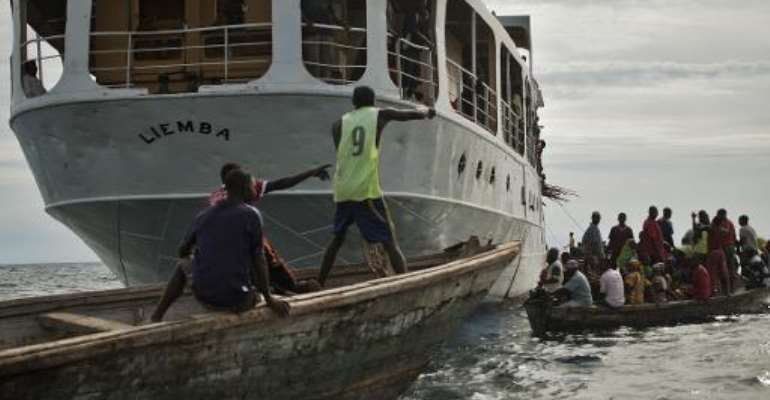 The MV Liemba, a century-old gunship gunship used during the reign of Germany's Kaiser Wilhelm II, is being used to carry Burundian refugees to safety in Tanzania.  By chris oke (AFP)