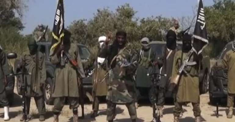 An image grab made on October 31, 2014 from a video obtained by AFP shows the leader of the Islamist extremist group Boko Haram Abubakar Shekau (C) delivering a speech.  By - (Boko Haram/AFP/File)