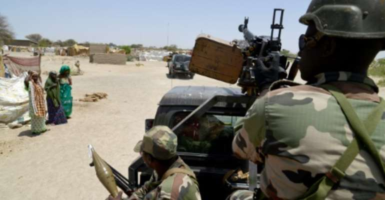Nigerien soldiers patroling on a road between Diffa and Bosso on May 25, 2015.  By Issouf Sanogo (AFP/File)