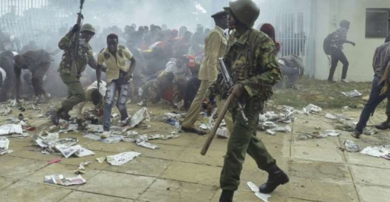 Chaos erupted at Kenya's Kasarani stadium in Nairobi as supporters of President Uhuru Kenyatta tried to get into the venue to attend his inauguration ceremony.  By SIMON MAINA (AFP)
