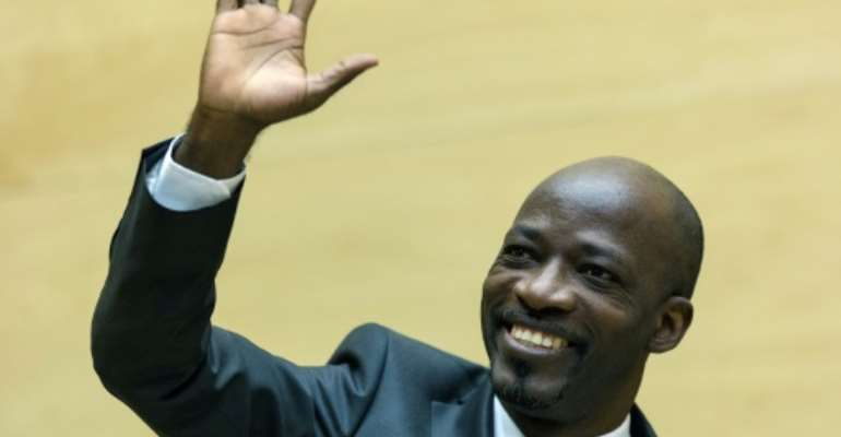 Charles Ble Goude was acquitted by the ICC -- his lawyers are now demanding compensation.  By MICHAEL KOOREN (POOL/AFP)