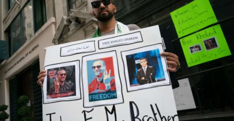 Chekib Drareni is seen outside the Algerian consulate in New York protesting Algeria's jailing of his brother, journalist Khaled Drareni.  By Bryan R. Smith (AFP)