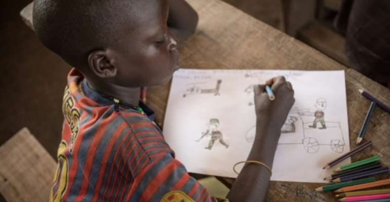 Children at the Lazare camp in Central African Republic are encouraged to draw as a form of therapy for post-traumatic stress disorder.  By FLORENT VERGNES (AFP)