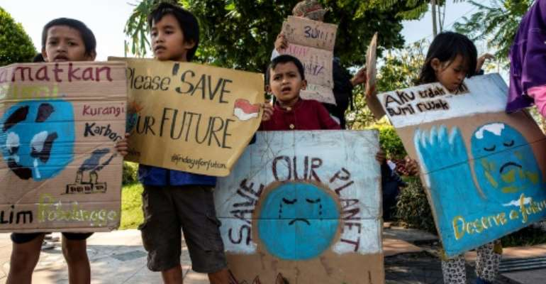 Children from Asia to Europe skipped school and took to the streets for the climate protest.  By Juni Kriswanto (AFP)