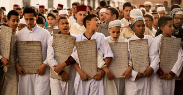 Children head to the Great Mosque of Sale near the Moroccan capital to pray for rain.  By FADEL SENNA (AFP)