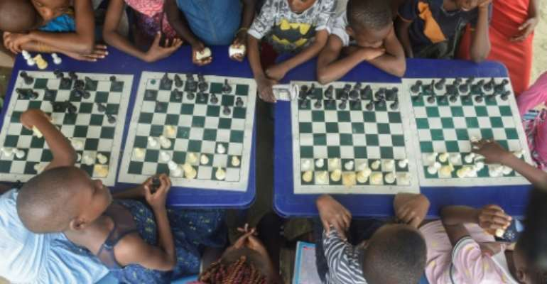 Children in a Lagos slum are being taught chess under a project aimed at bringing them hope and confidence.  By PIUS UTOMI EKPEI (AFP)