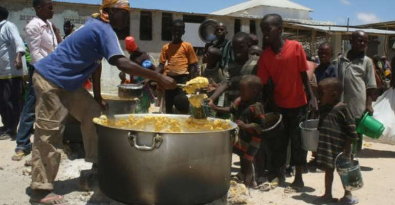Somali children receive food at a feeding center in the southern Mogadishu district of Howlwadag on April 14, 2012.  By Abdurashid Abdulle Abikar (AFP)