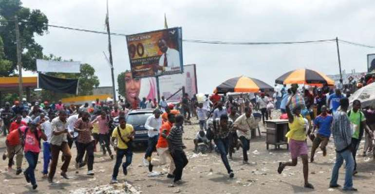Protesters run after soldiers opened fire to disperse a crowd on January 20, 2015 in Kinshasa, Democratic Republic of Congo.  By Papy Mulongo (AFP/File)
