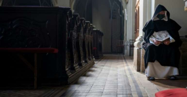 Churches around the world are nearly empty with billions of people stuck indoors due to lockdowns.  By JOE KLAMAR (AFP/File)