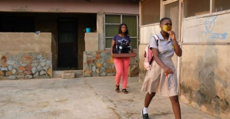 Cindy Anyetei, 13, heads out for her school in Accra. Classes were shut for 10 months because of coronavirus..  By Nipah Dennis (AFP)