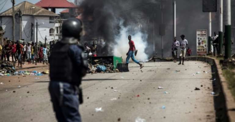 Cities across Guinea have been plagued by violence that has left around 10 people dead since Monday.  By JOHN WESSELS (AFP)