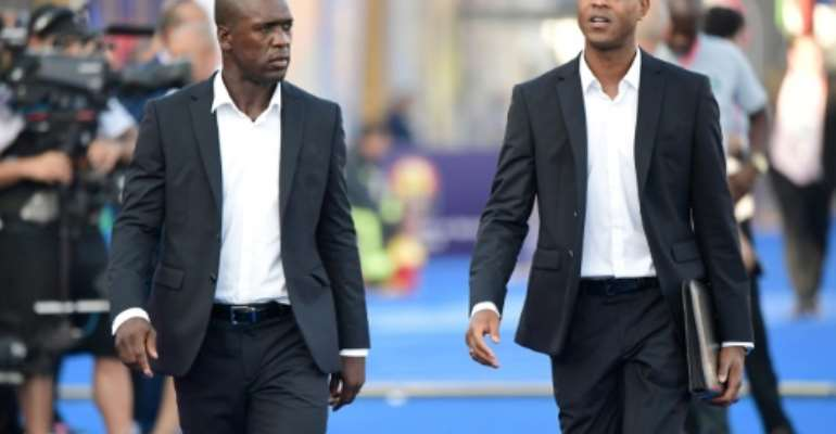 Clarence Seedorf and his assistant Patrick Kluivert arrive for the match against Nigeria in Africa Cup of Nations round of 16, their last in charge of Cameroon.  By JAVIER SORIANO (AFP/File)
