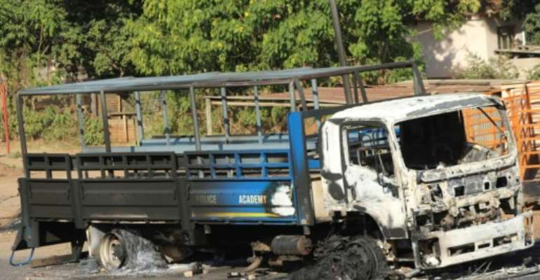 Clashes: A burned-out Police Academy truck in the city of Manzini.  By - (AFP/File)