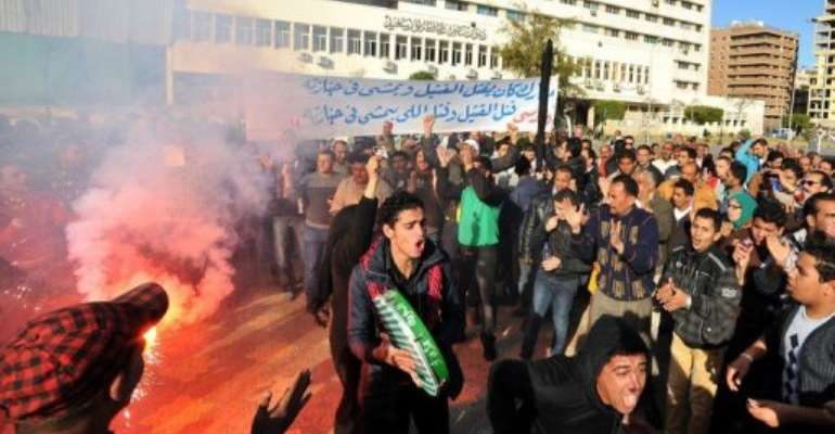 Egyptians protesters shout slogans outside the government office on February 21, 2013 in the canal city of Port Said.  By  (AFP/File)