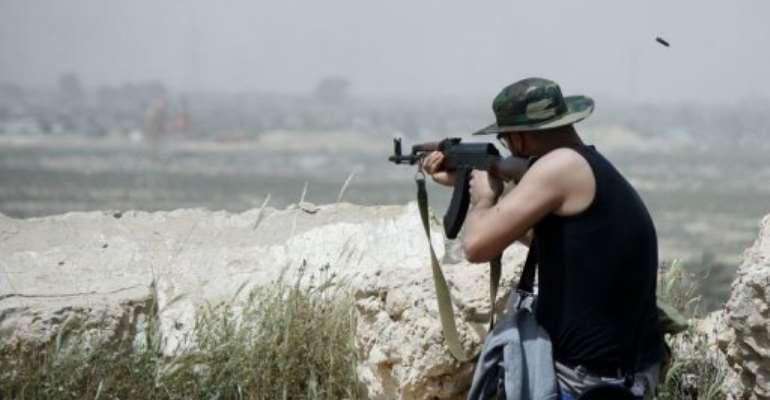 A Zuwarah fighter fires his weapon.  By Imed Lamloum (AFP)