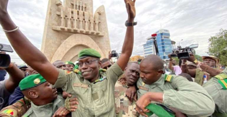 Col. Malick Diaw, deputy head of the new junta, greeted the crowd celebrating in Bamako's Independence Square.  By MALIK KONATE (AFP)
