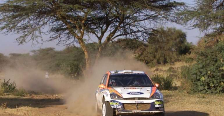 Colin McRae on his way to victory in the last leg of the last Safari Rally in 2002.  By SIMON MAINA (AFP/File)