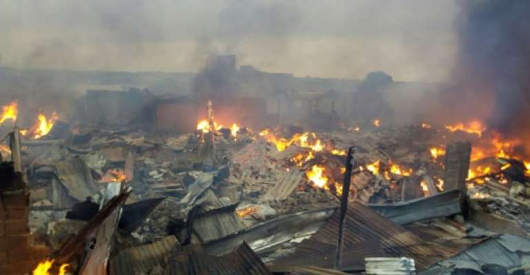 Collapsed stalls burned in the market in Bouake a day after fire broke out in the night.  By - (AFP)