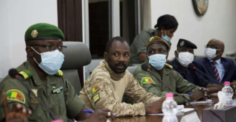 Colonel Assimi Goita, centre, has been granted presidential-like powers as head of the new junta, according to a document posted on Mali's official gazette.  By ANNIE RISEMBERG (AFP)