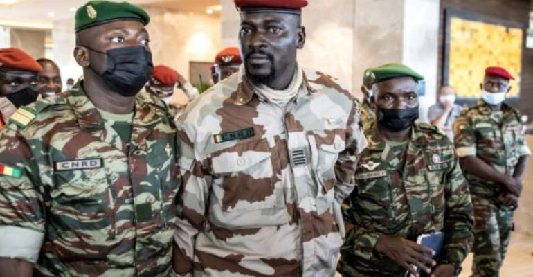 Guinea junta resists poll pressure, rules out exile for ex-president