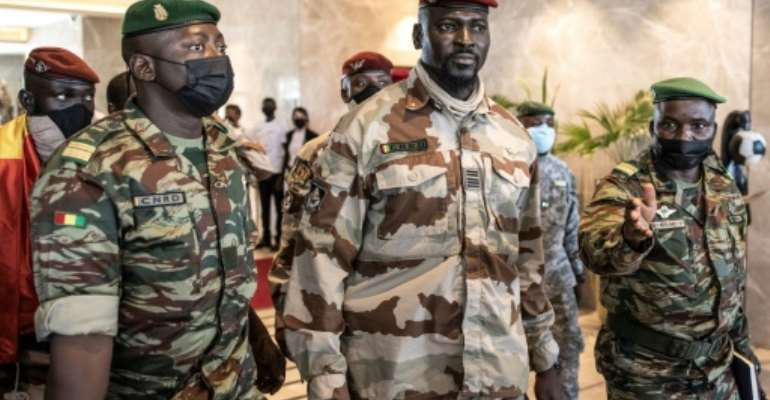 Colonel Mamady Doumbouya, centre, led the coup against President Alpha Conde.  By JOHN WESSELS (AFP)