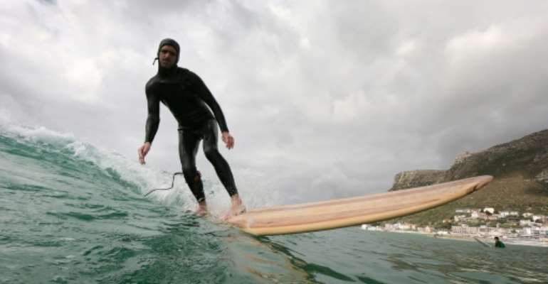 Comeback: Wooden surfboards became sidelined by synthetic materials. Green awareness has put them in the spotlight..  By ANTOINE DEMAISON (AFP)