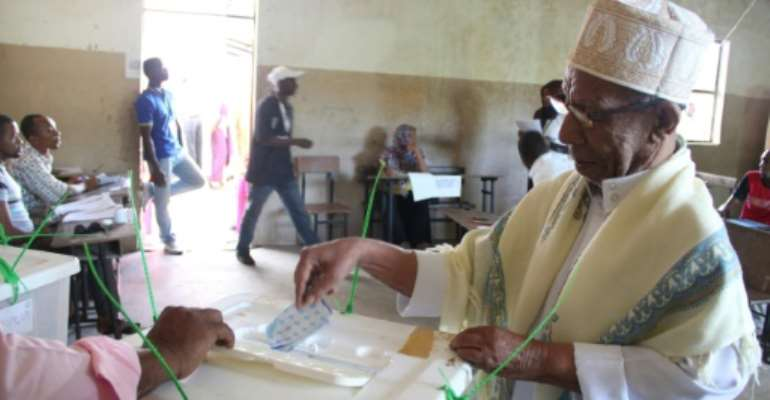 A man casts his ballot in Moroni during the second round of presidential elections in Comoros.  By Ibrahim Youssouf (AFP)