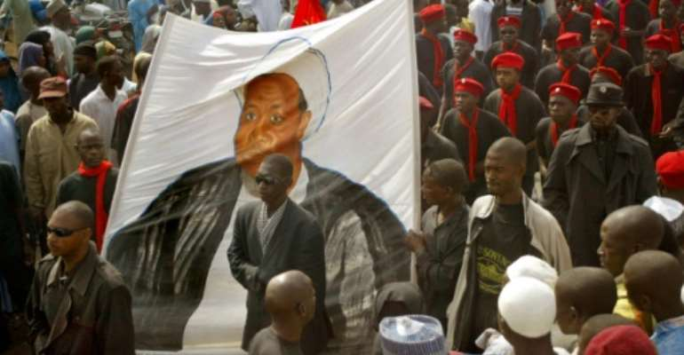 A series of demonstrations were staged win various parts of northern Nigeria, calling for the release of Ibrahim Zakzaky, depicted here on a banner in Kano, who was detained following a military crackdown on his followers.  By Pius Utomi Ekpei (AFP/File)