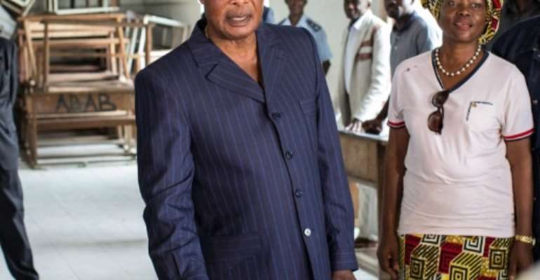 Incumbent Congolese President Denis Sassou Nguesso casts his ballot at a polling station during presidential elections in Brazzaville on March 20, 2016.  By Marco Longari (AFP/File)
