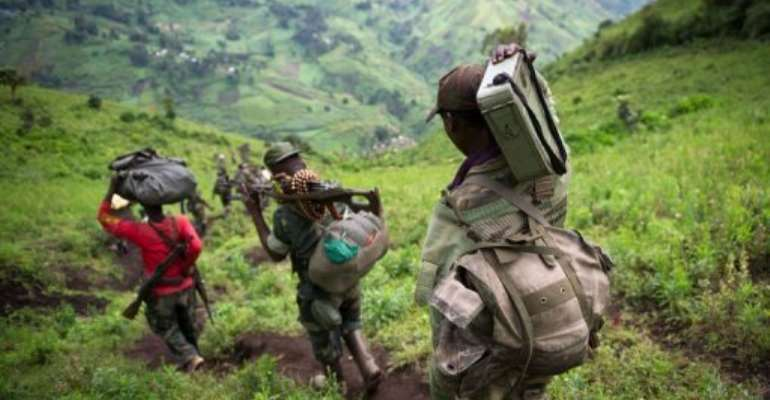 M23 rebels leave their position in the village of Karuba, eastern Democratic Republic of Congo, on November 30, 2012.  By Phil Moore (AFP/File)