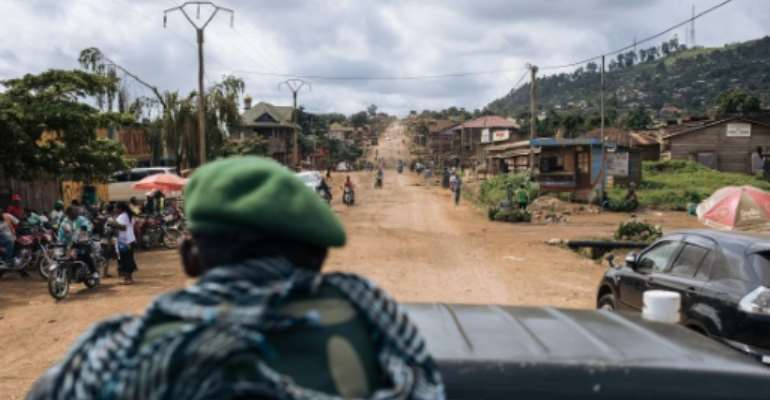 Congolese troops patrolling the highway from Beni to the Ugandan border. The road and its surrounding villages have suffered several dozen ADF attacks since last December.  By ALEXIS HUGUET (AFP)