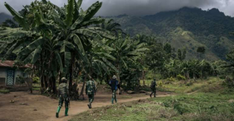 Congolese troops patrolling the village of Mwenda earlier this year. The village lies in an area that is notorious for attacks by the Allied Democratic Forces (ADF).  By ALEXIS HUGUET (AFP)