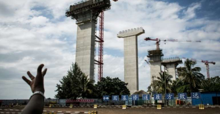 Construction work on the Chinese-built Maputo-Katembe Bridge, linking the two sides of the bay of Mozambique's capital. The three-kilometer, $725-million structure, scheduled to open this year, will be Africa's longest suspension bridge.  By JOHN WESSELS (AFP)