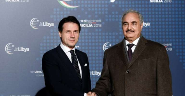 Conte (L) greeted Haftar upon his arrival in Palermo for the conference.  By Filippo MONTEFORTE (AFP)