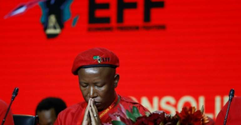 Controversial former ANC youth head Julius Malema was re-elected as head of the Economic Freedom Fighters -- but a decision to bar some local media caused a rumpus.  By Phill Magakoe (AFP)
