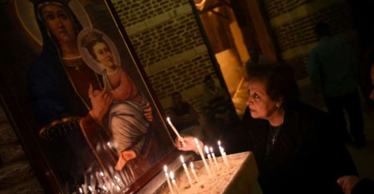 Coptic Christians make up around 12 percent of Egypt's population of 100 million.  By MOHAMED EL-SHAHED (AFP/File)
