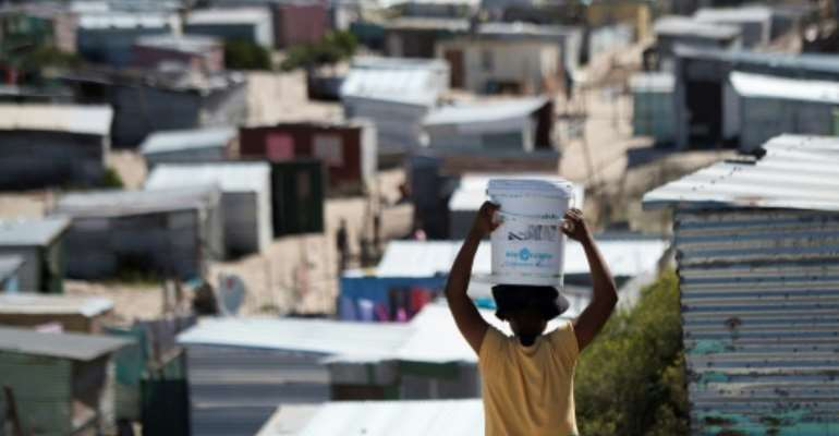 Coronavirus is starting to spread in South Safrica, but in Khayelitsha, a slum near Cape Town, even basic sanitation and running water are a dream.  By RODGER BOSCH (AFP)