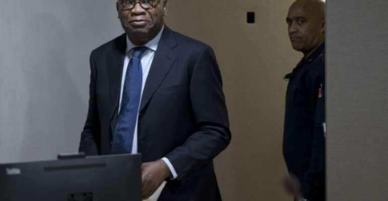 Former Ivory Coast president Laurent Gbagbo arrives for the start of his trial at the International Criminal Court in The Hague on January 28, 2016.  By Peter Dejong (Pool/AFP/File)