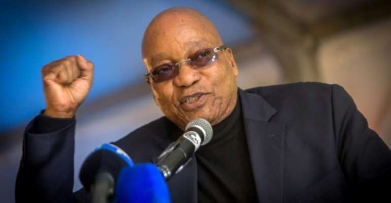 Credit ratings agency Moody's has downgraded South Africa to one notch above junk status over gloomy growth prospects and the political instability unleashed by corruption scandals engulfing President Jacob Zuma.  By RAJESH JANTILAL (AFP/File)