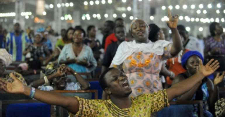 'Crossover' is an eagerly-awaited moment for many Nigerian Christians. Congregations pray throughout the night on New Year's Eve that the coming year will be good.  By PIUS UTOMI EKPEI (AFP)