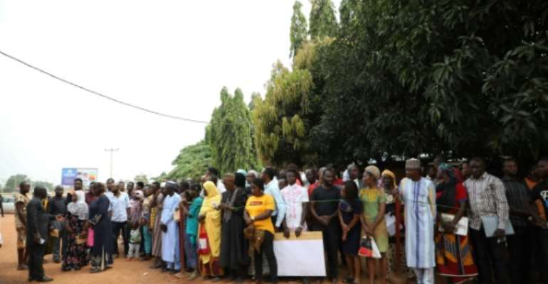 Crowds gather outside Ahmad Isah's radio studio every morning to get a chance to air their grievances.  By Kola Sulaimon (AFP)