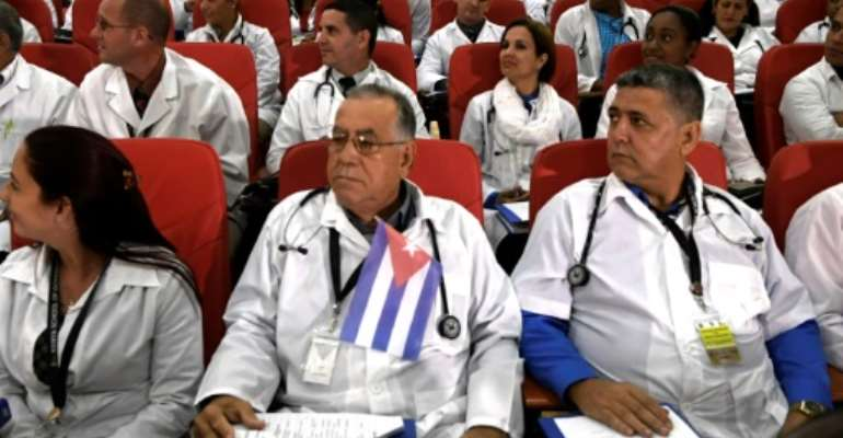 Cuba last year sent around 100 doctors to Kenya, seen here at their induction programme in Nairobi in June.  By SIMON MAINA (AFP)