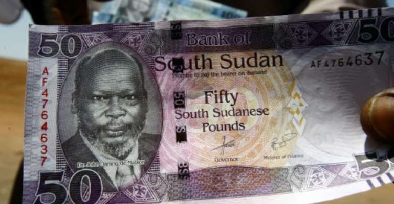 Currency slide: The Sudanese pound.  By ASHRAF SHAZLY (AFP)