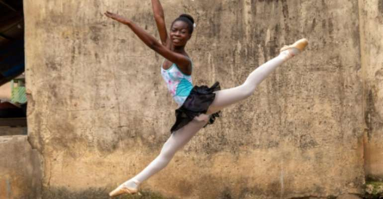 Dancing in the streets: A ballet student of the Leap of Dance Academy in a poor district of Nigerian megacity Lagos.  By Benson Ibeabuchi (AFP)