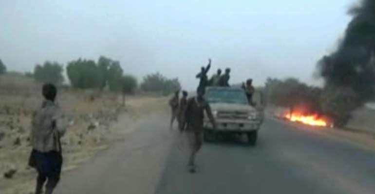 Dangerous roads: A screen grab from a January 2018 video released by Boko Haram, showing jihadists attacking the military on a highway near Maiduguri.  By Handout (BOKO HARAM/AFP/File)